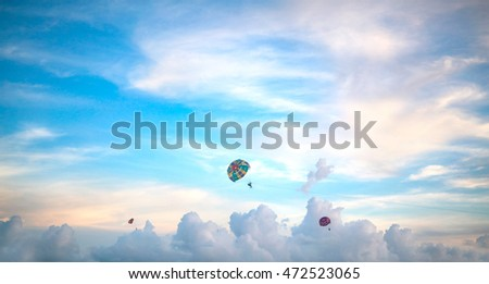 parachutes in sky