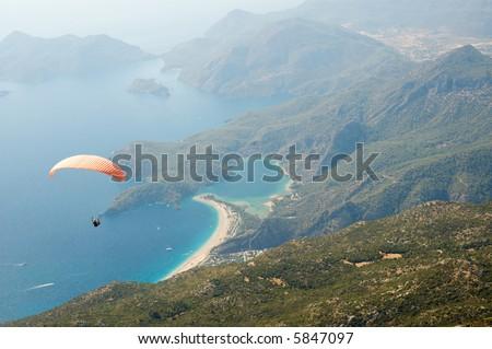 Parachuting over wonderful seascape of Oludeniz - stock photo