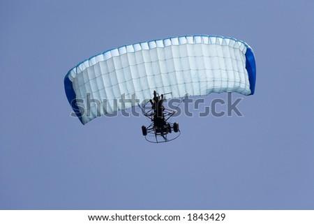 Parachuting Three-Wheeler - stock photo