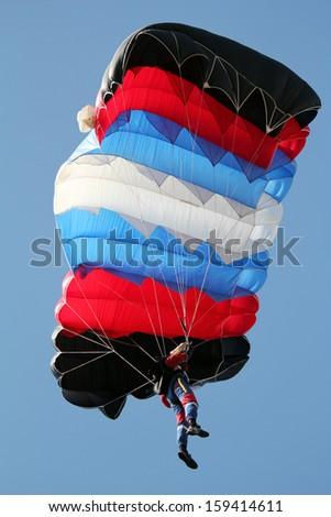parachutist on blue sky extreme sport - stock photo