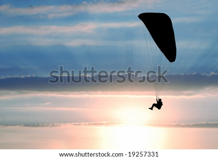 parachutist on sunset - colorful background - stock photo