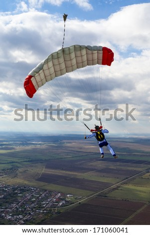 Parachutist pilots filled chute. - stock photo