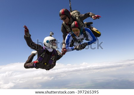 Parachutist student in tandem with an instructor. - stock photo