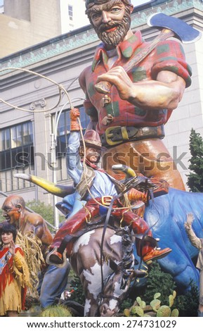 Parade float with Cowboy on bucking bronco and Paul Bunyan characters in Macy's Thanksgiving Day Parade, New York City, New York - stock photo