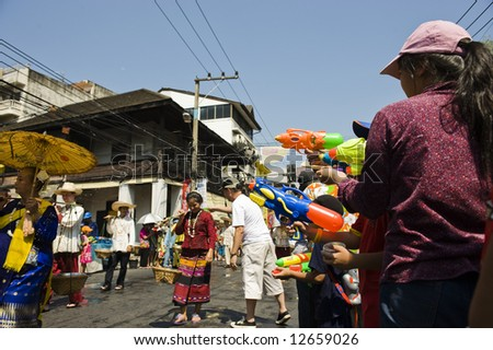 parading during songkran festival in Chiang Mai - stock photo