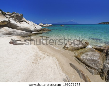 Paradise bay beach in Aegean sea, untouched nature abstract archipelago in seashore with rocks in water on peninsula Halkidiki, Greece - stock photo