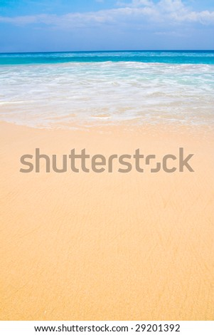 Paradise beach with blue sky and water and white sand in Bali, Indonesia.. - stock photo