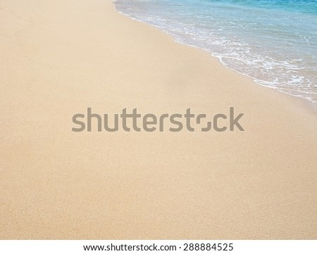 Paradise beach with golden sand and turquoise water in the edge. - stock photo