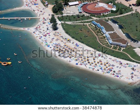 Paradise beach with people aerial view - stock photo