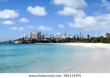 Paradise beach with white sand, blue sky and clear water in St. Martin (Caribbean islands) - stock photo