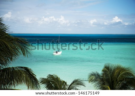 paradise in Mexico, boat in pristine blue water, Caribbean holiday