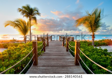 Paradise landscape, a bridge at sunset in the sea - stock photo