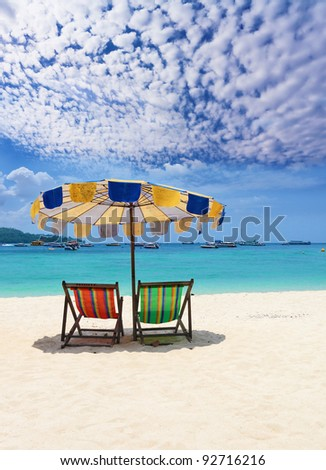 Paradise rest on a beach. Elegant beach chaise lounges on a beach of Rajlej near to Krabi, Thailand