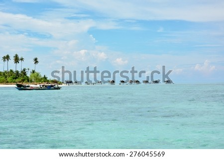 Paradise tropical island with the Sea Gypsy (Bajau Laut) flooting village in Maiga Island, Semporna, Sabah Borneo, Malaysia.  - stock photo
