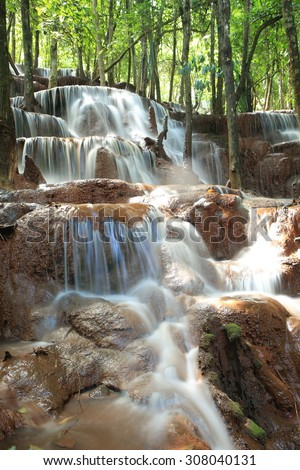 Paradise waterfall in Tropical rain forest of Thailand , water fall in deep forest at Tak province Thailand . The waterfall named Par Wai waterfall - stock photo