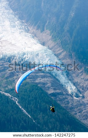 Paraglide over Alps ice-flow - stock photo