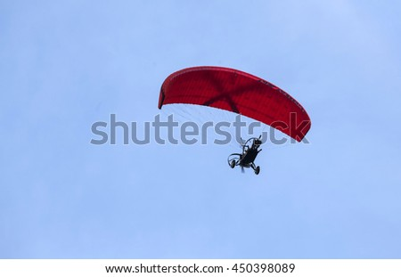 Paraglider againsy blue sky - stock photo