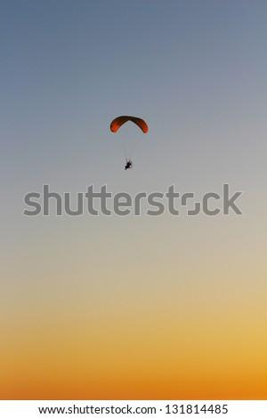 Paraglider at sunset over California coast, USA - stock photo