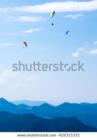 paraglider at the european alps - stock photo