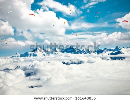 Paraglider flying against the Himalayas-Everest region, Nepal. - stock photo