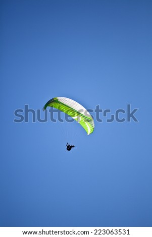 Paraglider flying over Appenins mountains  - stock photo
