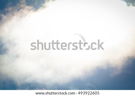 Paraglider flying through the clouds