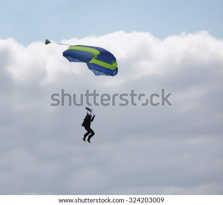 paraglider front of cloud