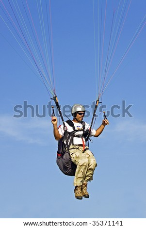 Paraglider pilot maneuver the wind, to fly