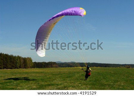 paraglider practising on the ground - stock photo
