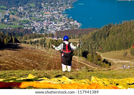paraglider preparing for a flight over St. Gilgen, Austria - stock photo