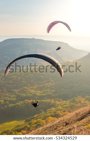 Paragliders in sunny day flying in Palava, hill Devin, South Moravia, Czech Republic