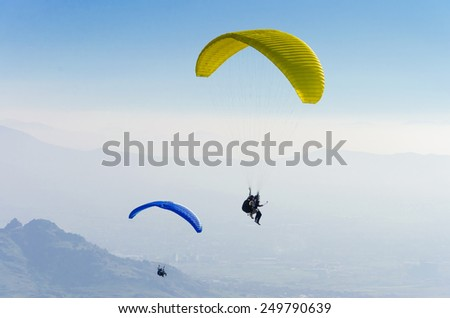 paragliders in the Alps - stock photo