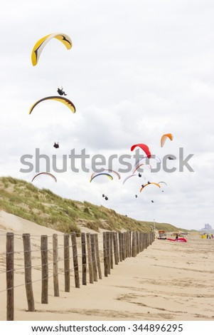 paragliding at the sea side, Netherlands, North Sea - stock photo