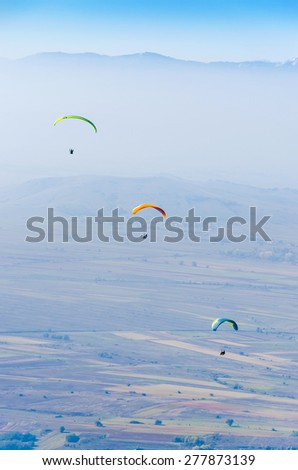 paragliding extreme sport - stock photo