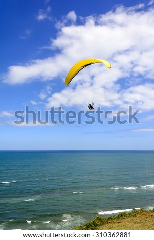Paragliding flight on the hill Lighthouse in Torres city, Rio Grande do Sul