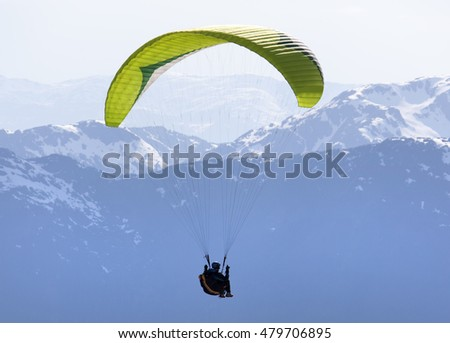 Paragliding high in Alaskan mountains (Juneau).