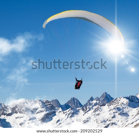 paragliding high in the blue sky - stock photo