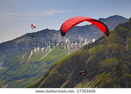 Paragliding in swiss alps near Pizol, Switzerland - stock photo