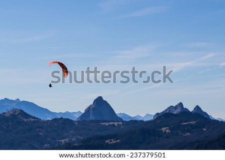 Paragliding in the mountains - stock photo