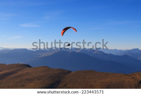 Paragliding in the mountains the Dolomites, Italy - stock photo