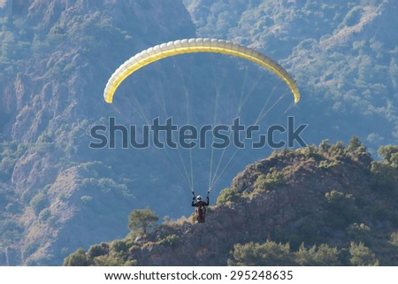 Paragliding in the sky - stock photo