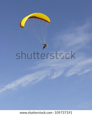 Paragliding in the sky and clouds