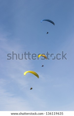 Paragliding on the blue sky