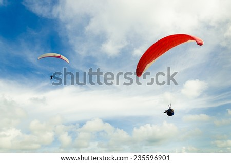 Paragliding on the sky - stock photo