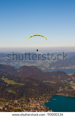 paragliding over mountains and  Wolfgangsee lake in austrian Alps