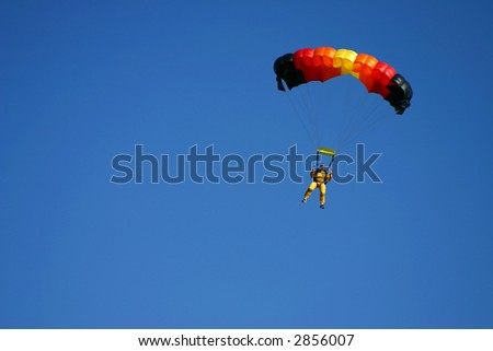 Paragliding pilots in the air - stock photo