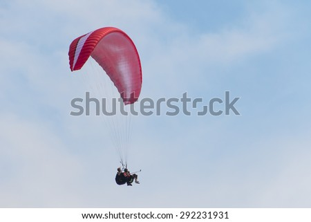 Paragliding tandem, duet - stock photo