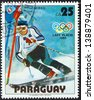 """PARAGUAY - CIRCA 1979: A stamp printed in Paraguay from the """"Winter Olympics, Lake Placid 1980"""" issue shows Paul Frommelt, Liechtenstein, slalom, circa 1979. - stock photo"""