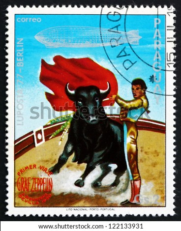 PARAGUAY - CIRCA 1977: a stamp printed in Paraguay shows Bull Fighter, Seville, Graf Zeppelin 1st South America Flight, circa 1977 - stock photo