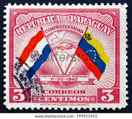 PARAGUAY - CIRCA 1945: a stamp printed in Paraguay shows Handshake, Map and Flags of Paraguay and Venezuela, Colombia, Goodwill Visit of President Higinio Morinigo, circa 1945 - stock photo